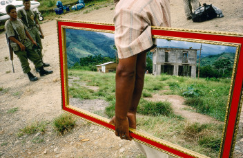 PERU. Palmapampa. 1993. Mirror vendor on a landing strip.
